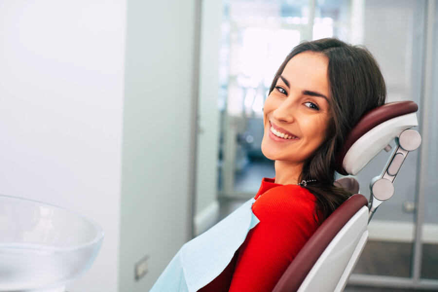 Endodontist Endodontics  Woman in red shirt at the dentist, endodontist, orthodontist