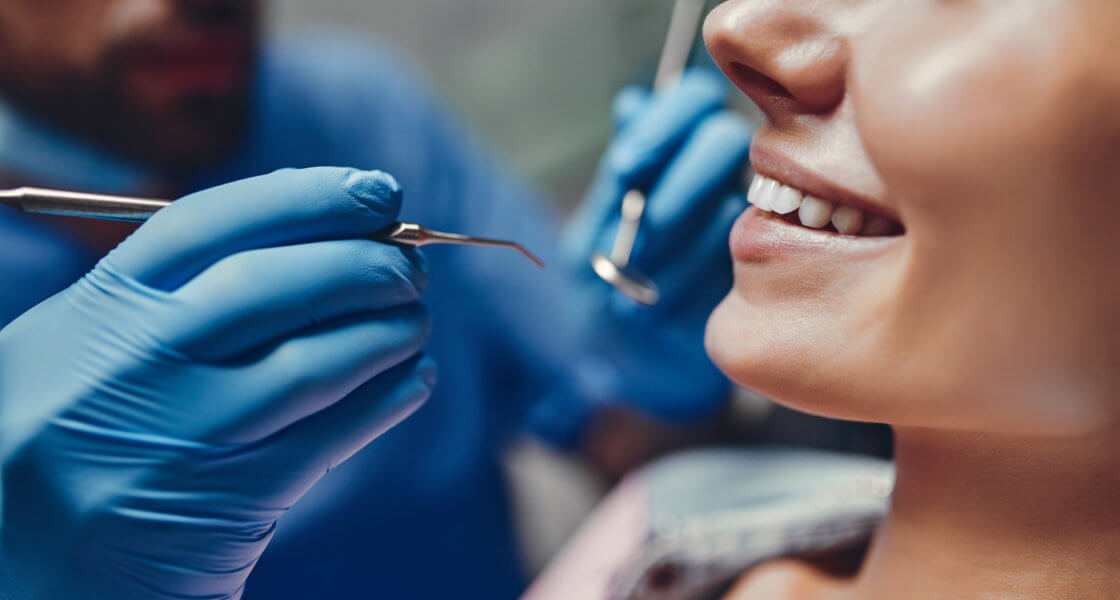root canal Attractive young woman in stomatology clinic with male dentist. Healthy teeth concept.