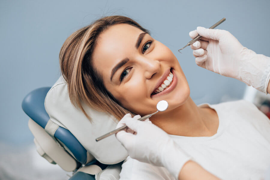 permanent nerve damage portrait of young caucasian woman with perfect smile in dental office, come to treat spoiled teeth, look at camera